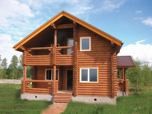 Из чего построить дом недорого и качественно. Оцилиндрованное бревно