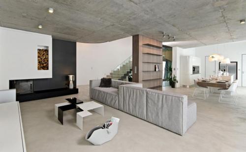 Отделка стен под бетон. Как сделать бетонную стену в интерьере: отделка под бетон